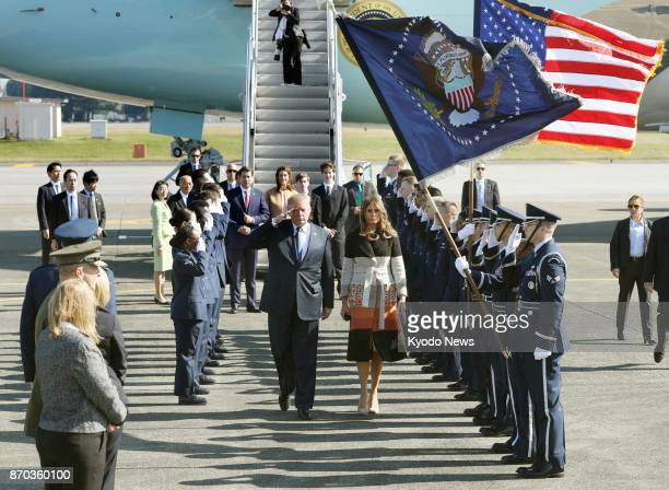 US President Donald Trump and first lady Melania Trump arrive at US Yokota Air Base in the suburbs of Tokyo on Nov 5 2017 for their first visit to...