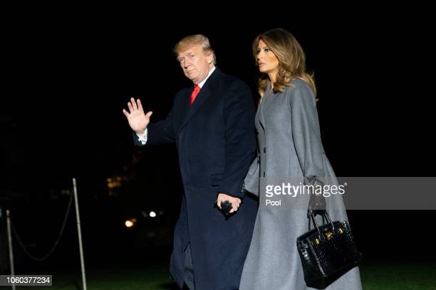 S President Donald Trump and first lady Melania Trump arrive back at the White House November 11 2018 in Washington DC The two travelled to Paris for...