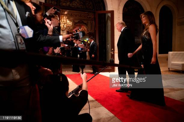 US President Donald Trump and First Lady Melania Trump arrive for a New Year's celebration at MaraLago in Palm Beach Florida on December 31 2019