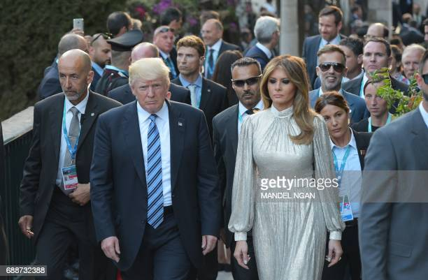 President Donald Trump and First Lady Melania Trump arrive for a concert of La Scala Philharmonic Orchestra at the ancient Greek Theatre of Taormina...