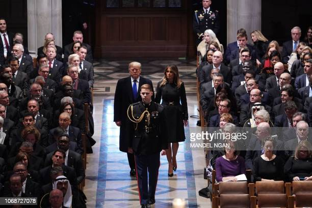 President Donald Trump and First Lady Melania Trump arrive for a funeral service for former US president George H W Bush at the National Cathedral in...