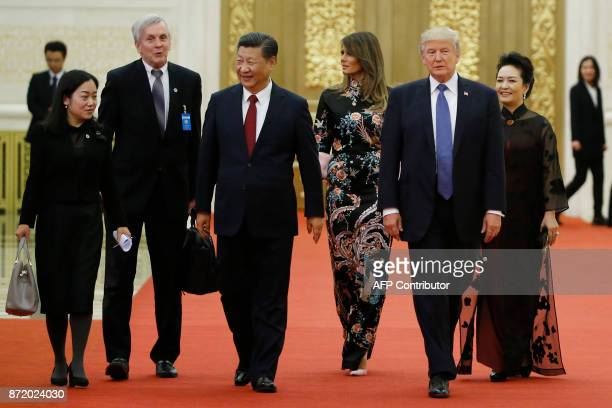 US President Donald Trump and First Lady Melania Trump arrive for a state dinner with China's President Xi Jinping and his wife Peng Liyuan at the...