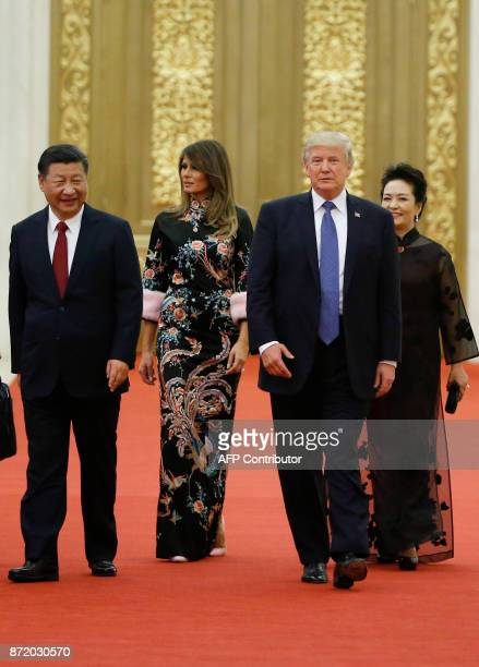 US President Donald Trump and First Lady Melania Trump arrive for a state dinner with China's President Xi Jinping and Xi's wife Peng Liyuan at the...