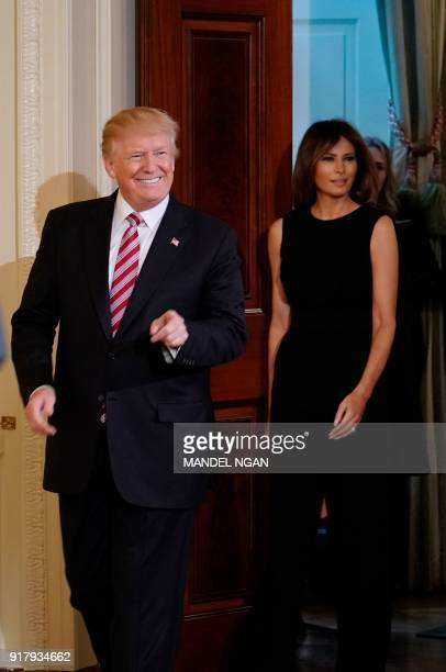 US President Donald Trump and First Lady Melania Trump arrive for a National African American History Month reception in the East Room of the White...