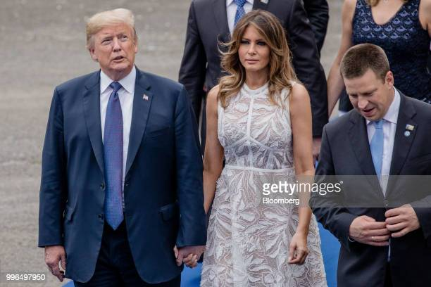 US President Donald Trump and First Lady Melania Trump arrive for a working dinner during the North Atlantic Treaty Organization summit at the museum...