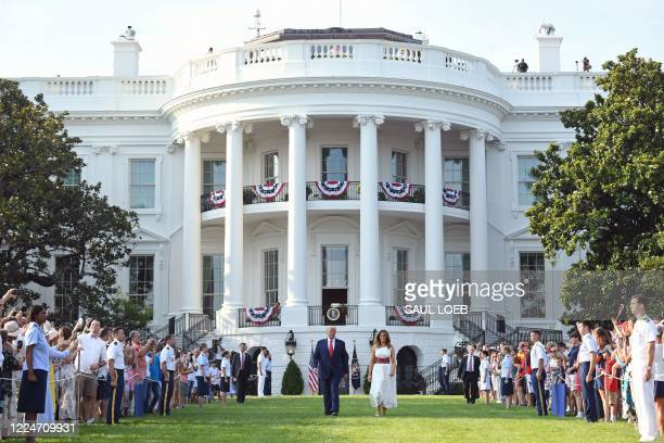 "President Donald Trump and First Lady Melania Trump arrive for the 2020 ""Salute to America"" event in honor of Independence Day on the South Lawn of..."