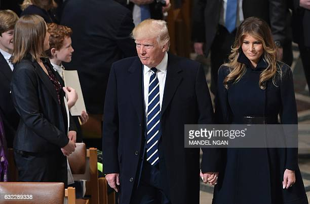 US President Donald Trump and First Lady Melania Trump arrive for the National Prayer Service at the National Cathedral on January 21 in Washington...