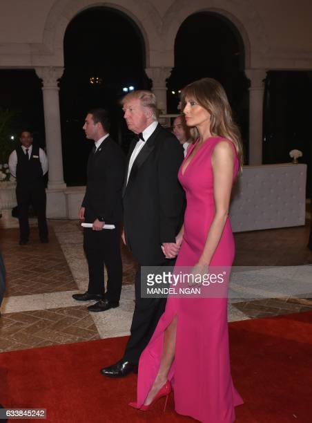 US President Donald Trump and First Lady Melania Trump arrive for the 60th Annual Red Cross Gala at his MaraLago estate in Palm Beach on February 4...