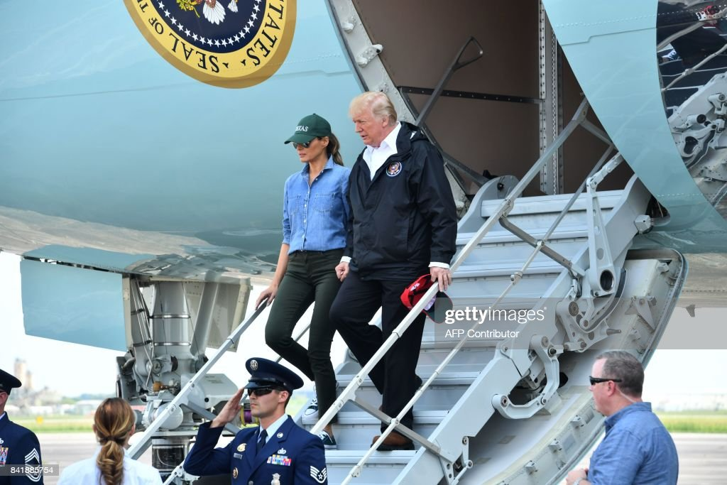 US President Donald Trump and First Lady Melania Trump arrive in Ellington Field in Houston on September 2, 2017. The Trumps arrived in Houston on Saturday to meet victims of the epic floods which devastated large parts of the fourth largest US city. / AFP PHOTO / Nicholas Kamm