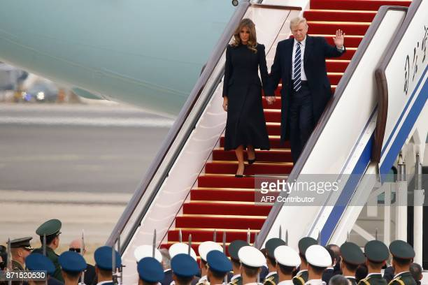 President Donald Trump and First Lady Melania Trump arrive on Air Force One in Beijing on November 8 2017 US President Donald Trump arrived in...