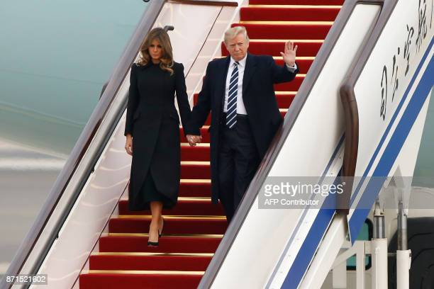 US President Donald Trump and First Lady Melania Trump arrive on Air Force One in Beijing on November 8 2017 US President Donald Trump arrived in...