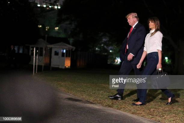 S President Donald Trump and First Lady Melania Trump arrive on the South Lawn of the White House on July 16 2018 in Washington DC President Trump...