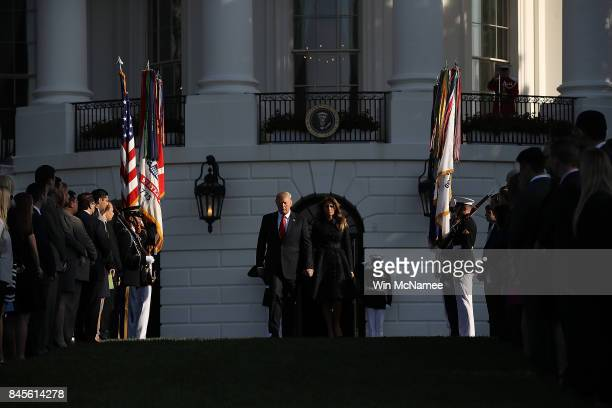 S President Donald Trump and first lady Melania Trump arrive on the South Lawn of the White House for a ceremony marking the September 11 terrorist...