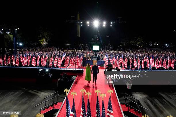 President Donald Trump and first lady Melania Trump arrive onstage where Trump delivered his acceptance speech for nomination to a second term as...
