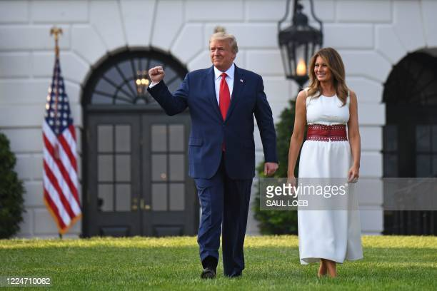 "President Donald Trump and First Lady Melania Trump arrive to host the 2020 ""Salute to America"" event in honor of Independence Day on the South Lawn..."