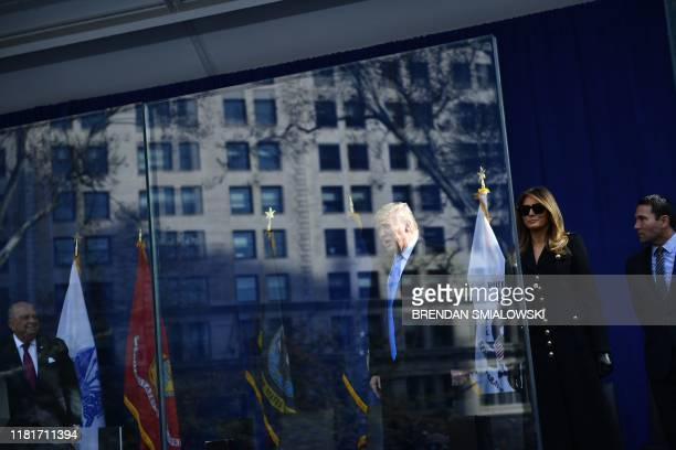 President Donald Trump and First Lady Melania Trump arrive to participate in a wreath laying and deliver remarks at the New York City Veterans Day...