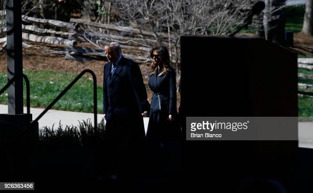 S President Donald Trump and first lady Melania Trump arrive to join mourners paying their respects at a funeral service for Rev Billy Graham at the...