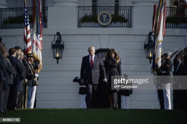 US President Donald Trump and First Lady Melania Trump arrive to observe a moment of silence on September 11 at the White House in Washington DC...