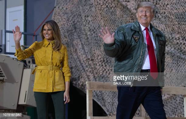US President Donald Trump and First Lady Melania Trump arrive to speak to members of the US military during an unannounced trip to Al Asad Air Base...
