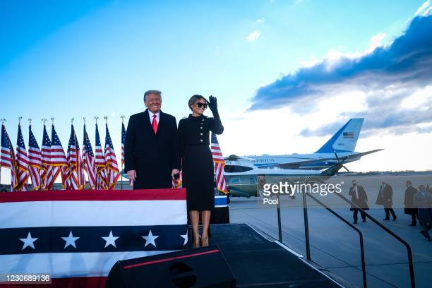 President Donald Trump and first lady Melania Trump arrive to speak to supporters prior to boarding Air Force One to head to Florida on January 20,...