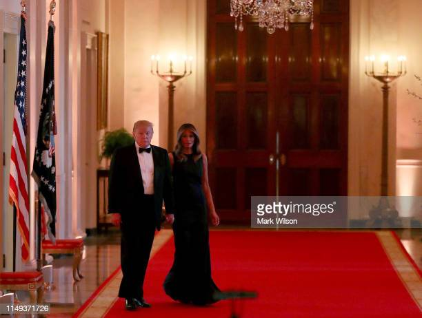 S President Donald Trump and first lady Melania Trump arrive to the White House Historical Association Dinner in the East Room of the White House on...