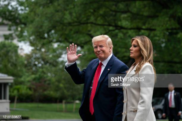 President Donald Trump and first lady Melania Trump arrive to the South Lawn of the White House after a trip to Baltimore, Maryland on May 25, 2020...