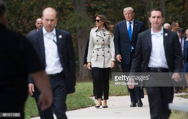 President Donald Trump and First Lady Melania Trump arrive to watch a K-9 dog demonstration at the United States Secret Service James J. Rowley...
