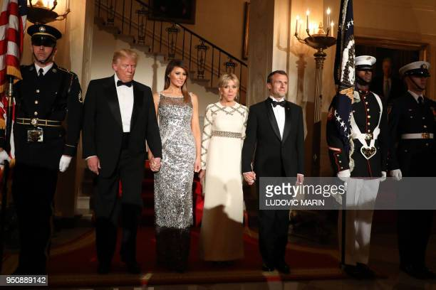 President Donald Trump and First Lady Melania Trump arrive with French President Emmanuel Macron and his wife Brigitte Macron for a State Dinner in...