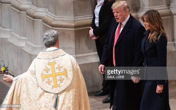US President Donald Trump and First Lady Melania Trump attend a Christmas Eve service at Washington National Cathedral in Washington DC on December...