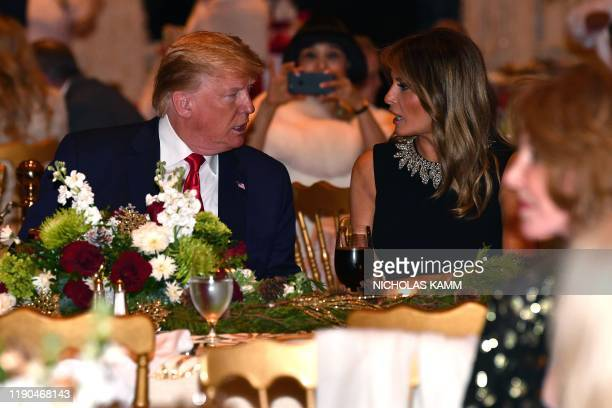 US President Donald Trump and First Lady Melania Trump attend a Christmas Eve dinner with his family at MarALago in Palm Beach Florida on December 24...