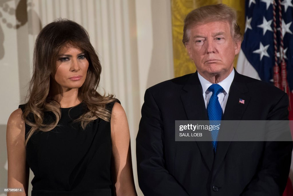 President Donald Trump and First Lady Melania Trump attend a Hanukkah reception in the East Room of the White House in Washington, DC, December 7, 2017. /