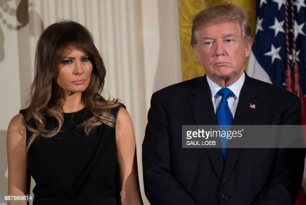 President Donald Trump and First Lady Melania Trump attend a Hanukkah reception in the East Room of the White House in Washington DC December 7 2017...