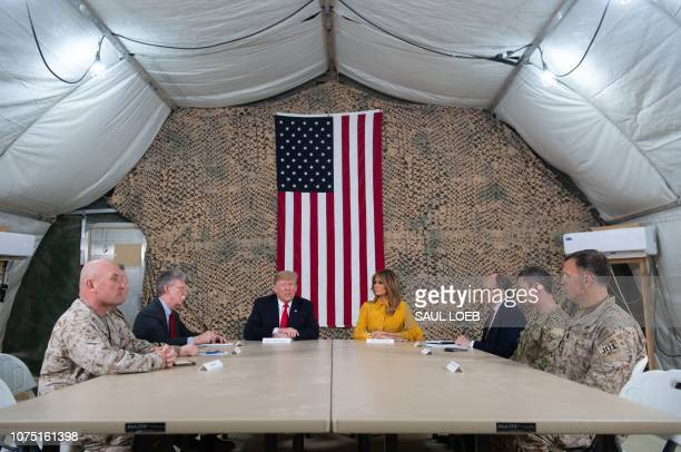President Donald Trump and First Lady Melania Trump attend a military briefing during an unannounced trip to Al Asad Air Base in Iraq on December 26...