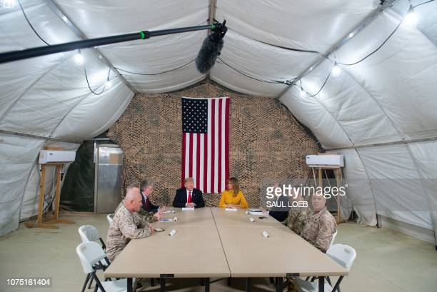 US President Donald Trump and First Lady Melania Trump attend a military briefing during an unannounced trip to Al Asad Air Base in Iraq on December...