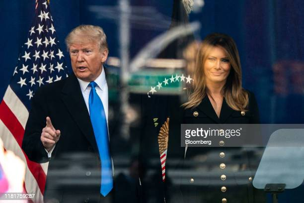 US President Donald Trump and First Lady Melania Trump attend a wreath laying ceremony at the Eternal Light Monument in Madison Square Park during...