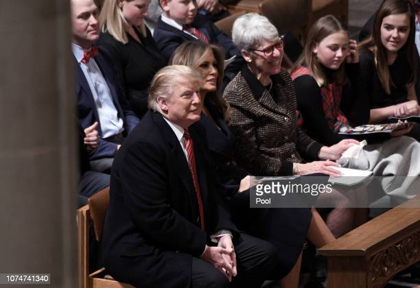 US President Donald Trump and first lady Melania Trump attend Christmas Eve services at the National Cathedral on December 24 2018 in Washington DC