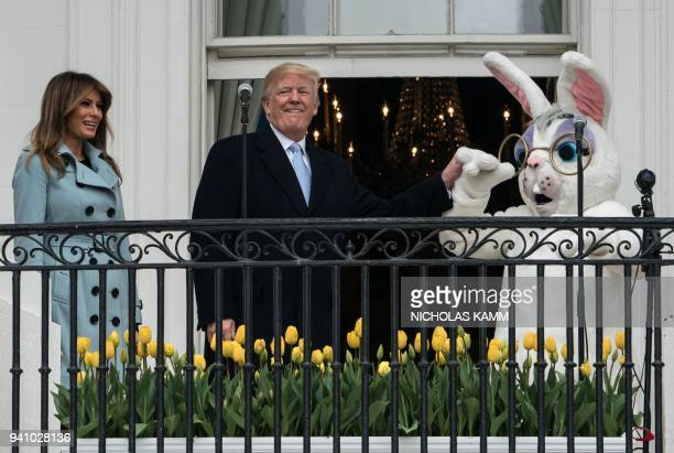 US President Donald Trump and First Lady Melania Trump attend the annual Easter Egg Roll at the White House in Washington DC on April 2 2018 / AFP...