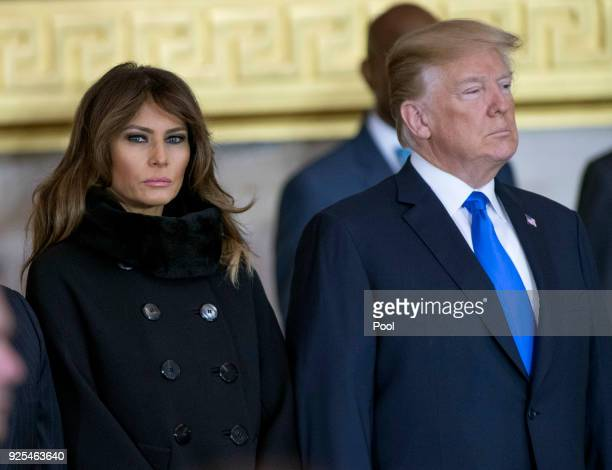 President Donald Trump and first lady Melania Trump attend the ceremonies as the late evangelist Billy Graham lies in repose at the US Capitol on...