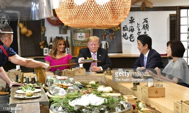 US President Donald Trump and First Lady Melania Trump attend the dinner with Japanese Prime Minister Shinzo Abe and his wife Akie at Inakaya...