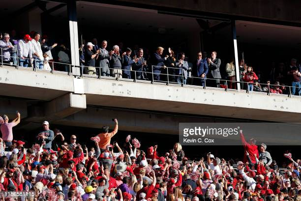 President Donald Trump and first lady Melania Trump attend the game between the LSU Tigers and the Alabama Crimson Tide at BryantDenny Stadium on...