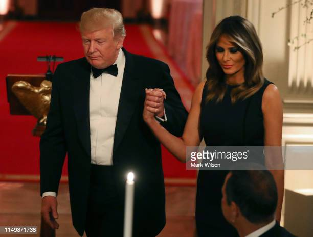 S President Donald Trump and first lady Melania Trump attend the White House Historical Association Dinner in the East Room of the White House on May...