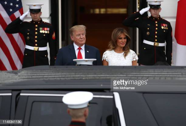 S President Donald Trump and first lady Melania Trump await the arrival of Japanese Prime Minister Shinzo Abe and his wife Akie Abe to the White...
