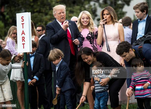 WASHINGTON DC President Donald Trump and First Lady Melania Trump blow the whistle to begin an Easter egg roll at the 139th White House Easter Egg...
