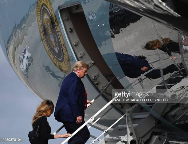 President Donald Trump and First Lady Melania Trump board Air Force One at Palm Beach International Airport in West Palm Beach, Florida, on December...