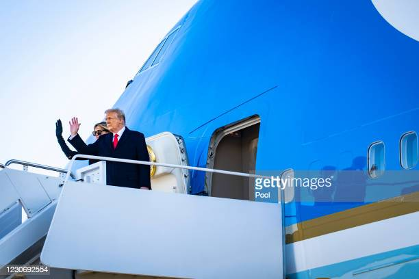 President Donald Trump and First Lady Melania Trump board Air Force One at Joint Base Andrews before boarding Air Force One for his last time as...