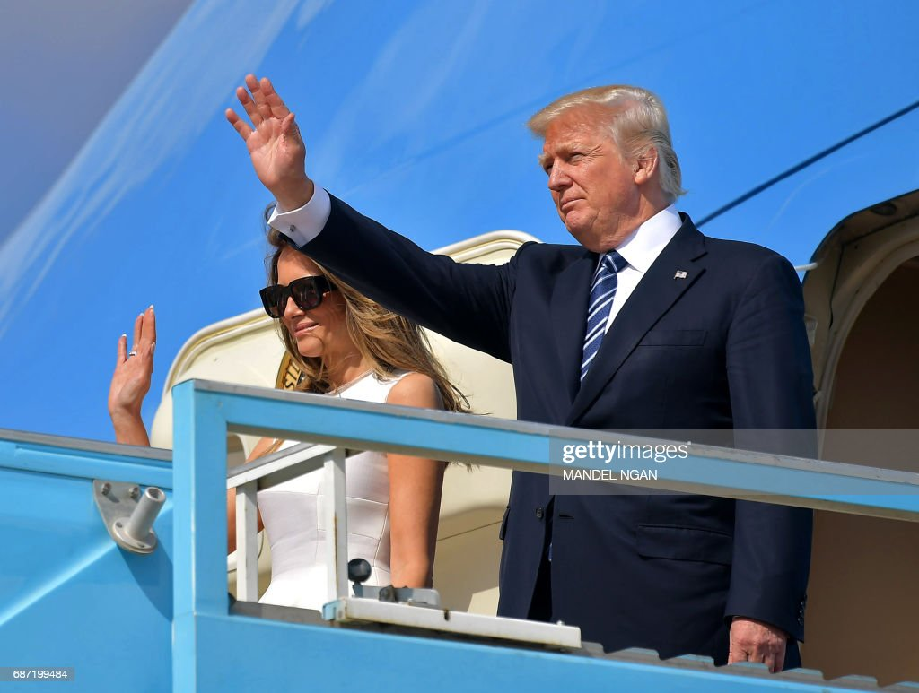 US President Donald Trump and First Lady Melania Trump board Air Force One before departing from Ben Gurion International Airport in Tel Aviv on May 23, 2017. /
