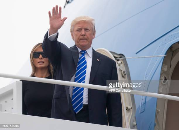 US President Donald Trump and First Lady Melania Trump board Air Force One prior to departure from Andrews Air Force Base in Maryland July 5 as they...
