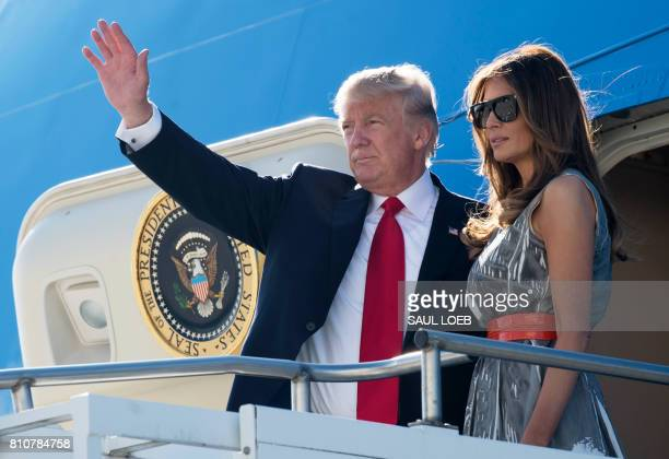 US President Donald Trump and First Lady Melania Trump board Air Force One prior to departure from Hamburg Airport in Hamburg Germany July 8...