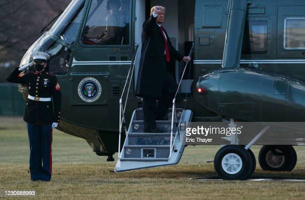President Donald Trump and first lady Melania Trump board Marine One as they depart the White House on January 20, 2021 in Washington, DC. President...