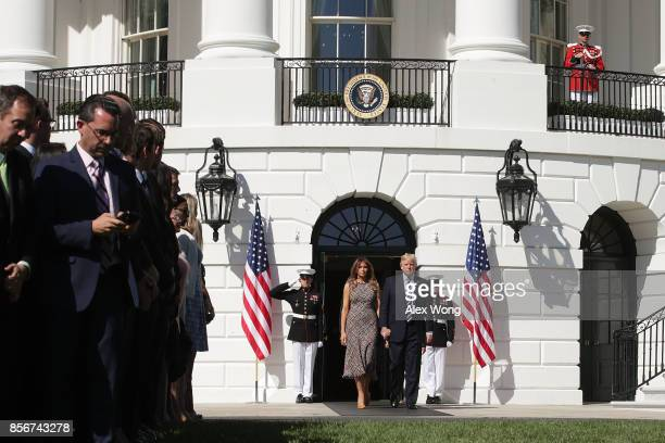 S President Donald Trump and first lady Melania Trump come out of the residence to lead a moment of silence for the victims of the Las Vegas shooting...
